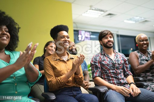 600073884 istock photo Business team applauding a work presentation 1145315315