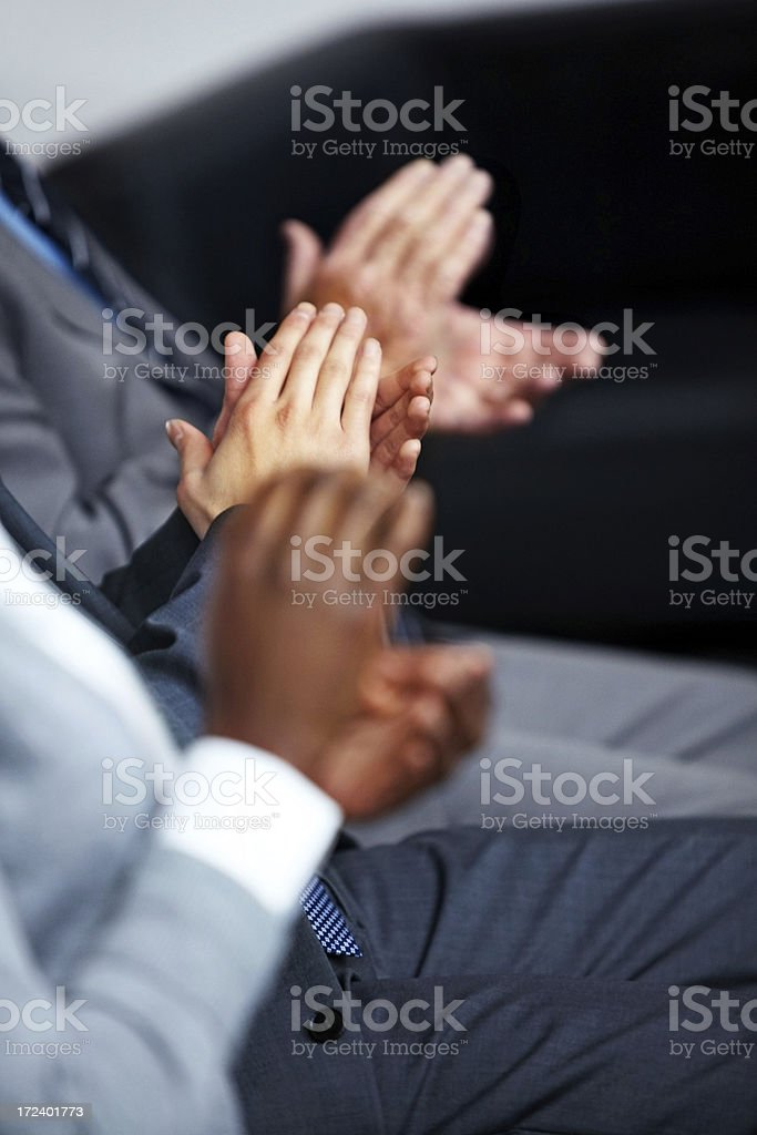Business team applauding at a conference royalty-free stock photo