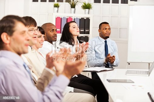 istock Business team applauding at conference table 466390746