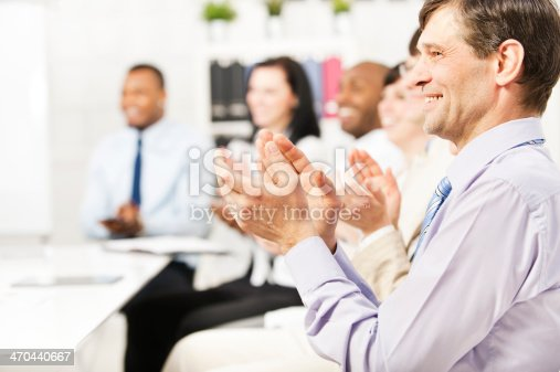 istock Business team applauding at conference table 470440667