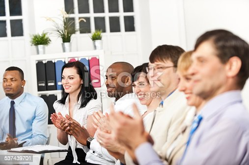 istock Business team applauding at conference table 537439701