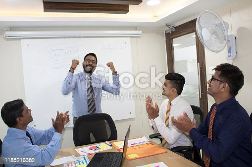 938516440 istock photo Business team applauding for successful manager at meeting 1185216382