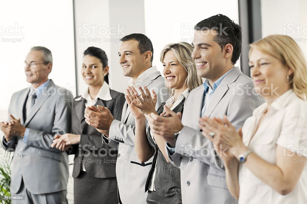 Business team applauding in a row royalty-free stock photo