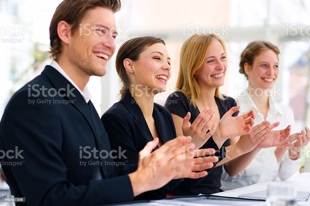 Business team applauding royalty-free stock photo