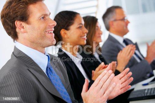 497183120 istock photo Business team applauding 145909651