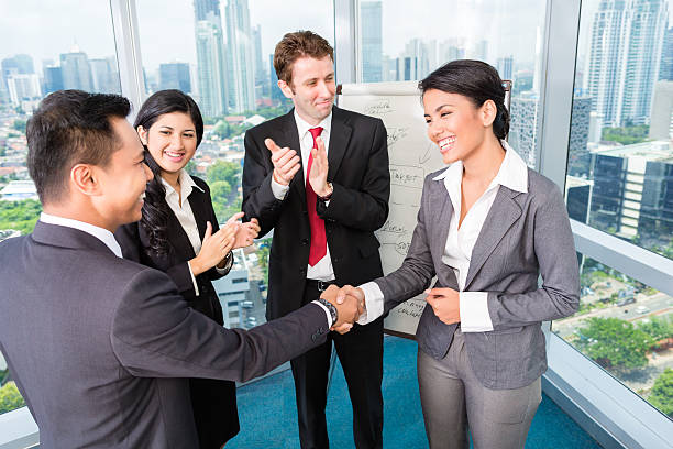 Royalty free meet and greet pictures images and stock photos istock business team applause in meeting stock photo m4hsunfo