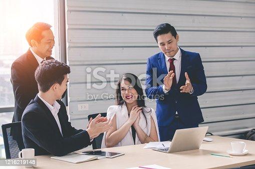 913332100 istock photo business team Asian congratulating Colleague 1216219148