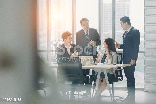 913332100 istock photo business team Asian congratulating Colleague 1216219186