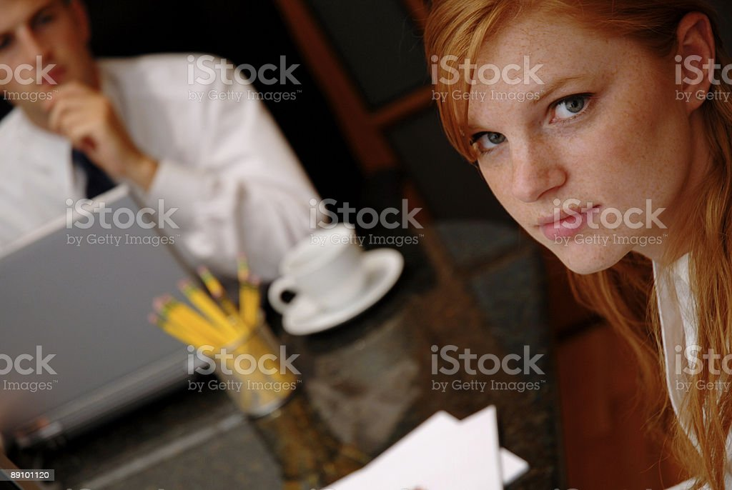 Business team at a boardroom in a pensive mood stock photo