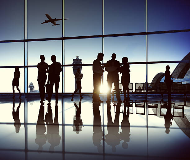 business team at the airport - airport terminal stock photos and pictures