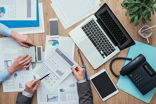 Business team at work Business team working at office desk and analyzing financial reports, finance and accounting concept, top view financial report stock pictures, royalty-free photos & images