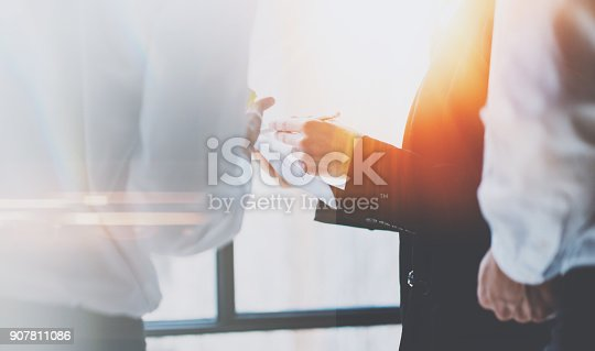 istock Business team at working process.Young professionals work with new crafting startup.Project managers meeting.Panoramic windows on blurred background.Horizontal. 907811086