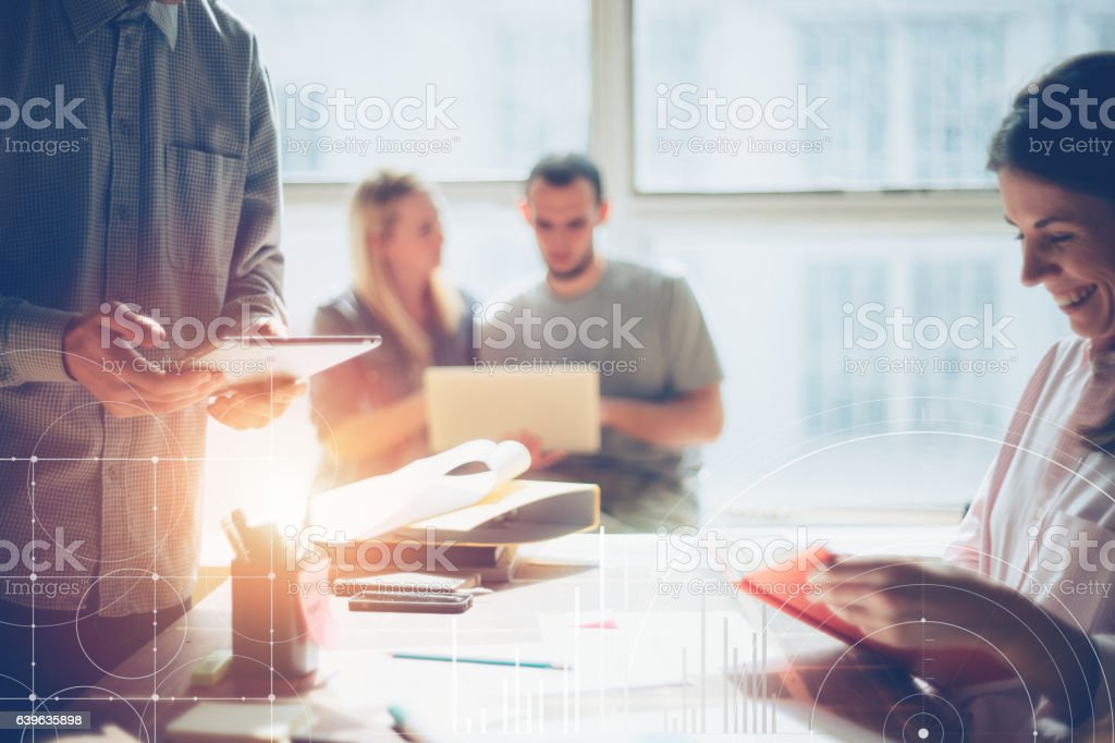 Business team brainstorming. Marketing plan researching stock photo