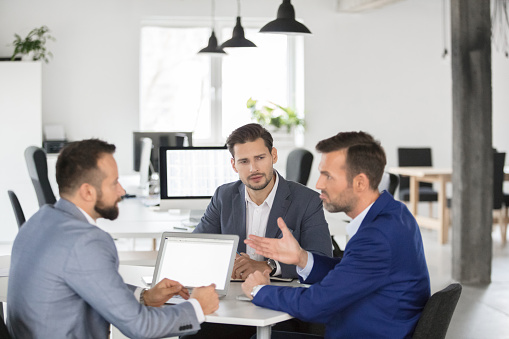 Business Team Brainstorming Over New Strategy In Meeting Stock Photo - Download Image Now