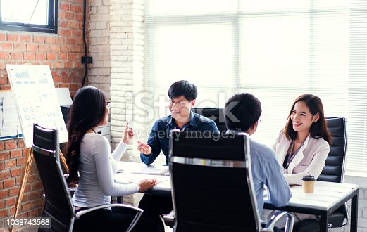 istock Business team brainstorming while sitting at the office table together 1039743568