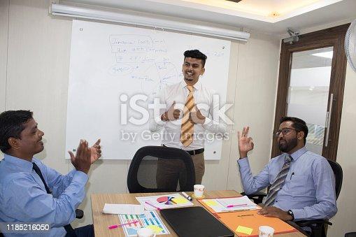 938516440 istock photo Business team celebrating on achieving goals 1185216050