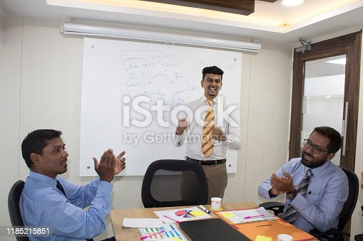 938516440 istock photo Business team celebrating success 1185215851