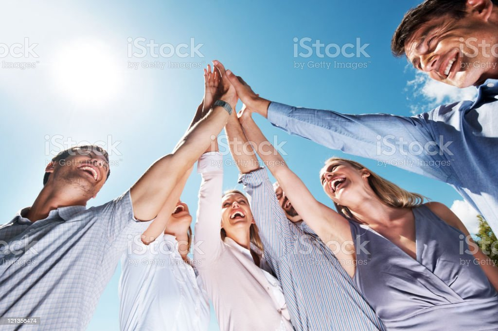 Business team celebrating success with high five royalty-free stock photo