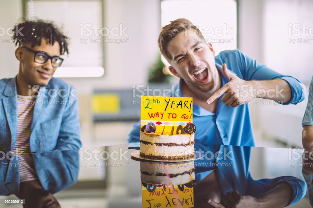 Business team celebrating their second year stock photo