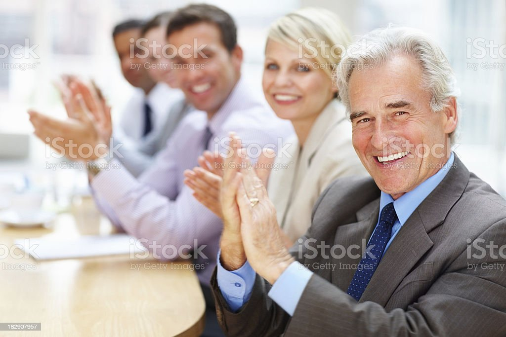 Business team clapping in meeting royalty-free stock photo