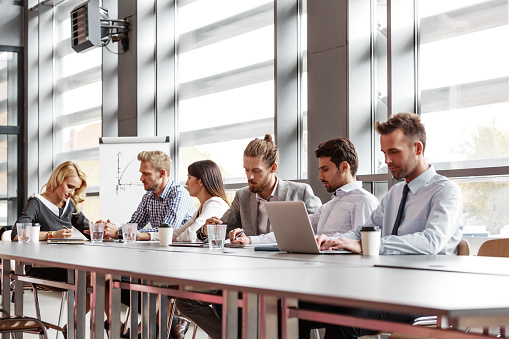 Business Team Collaborating In Board Room Stock Photo - Download Image Now