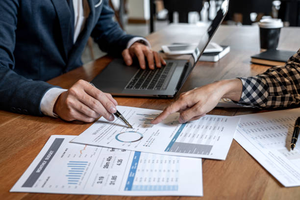 Business team collaboration discussing working analysis with financial data and marketing growth report graph in team to making growth profit, Partner meetings and briefing stock photo