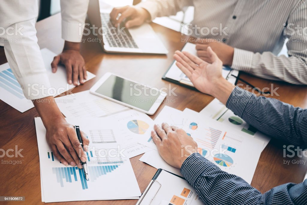 Business team colleagues meeting to conference professional investor working and discussing a new marketing business strategy project, Business finance and accounting concept stock photo