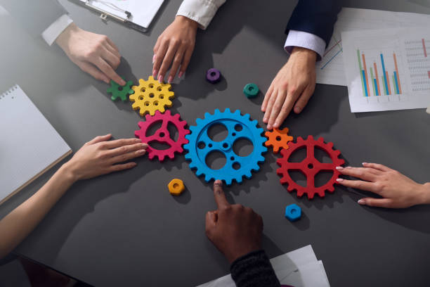 Business team connect pieces of gears. Teamwork, partnership and integration concept Teamwork of businesspeople work together and combine pieces of gears. Partnership and integration concept collaboration stock pictures, royalty-free photos & images