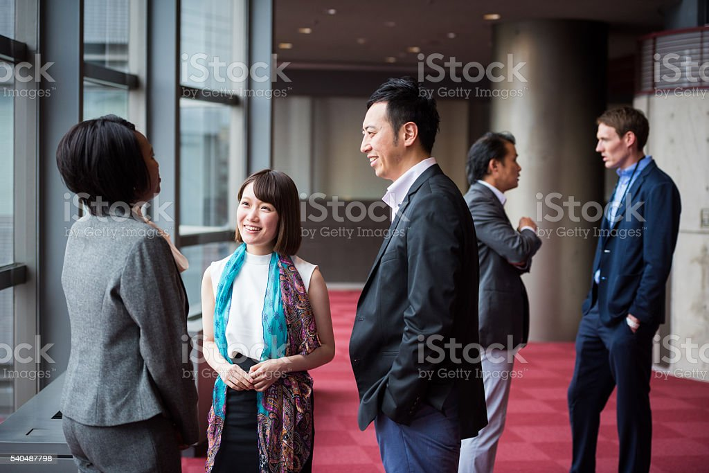Business team consulting in the foyer at a conference圖像檔