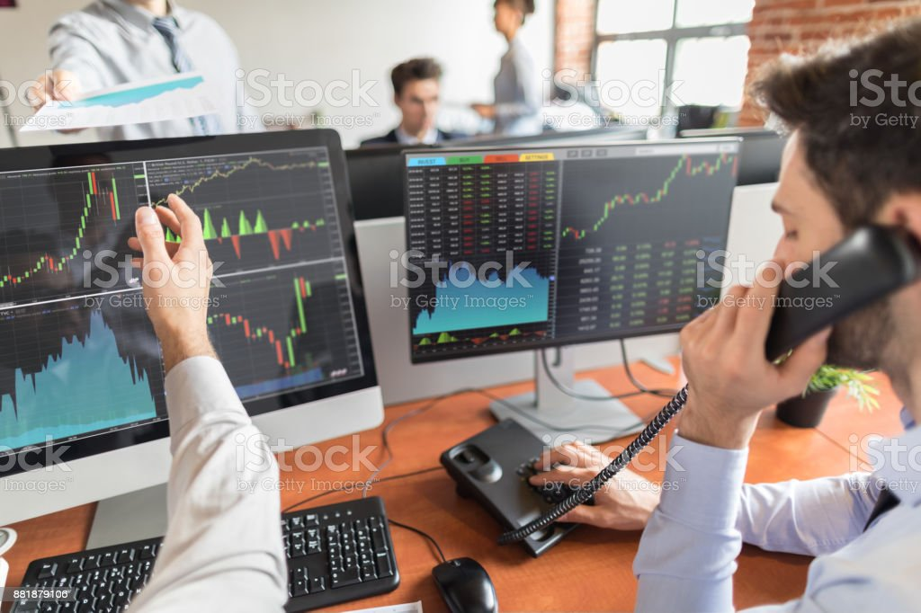 Business team deal on a stock exchange. Stock traders concept. stock photo
