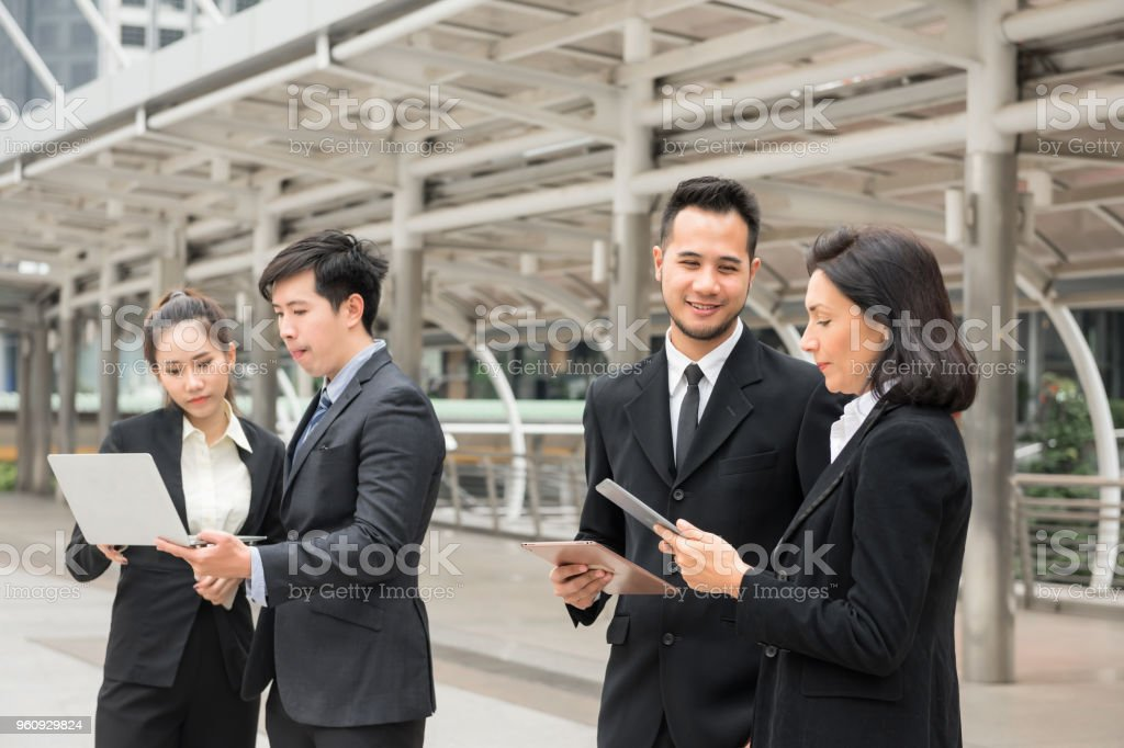 Business team discuss project in town stock photo