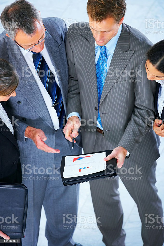 Business team discussing a document royalty-free stock photo