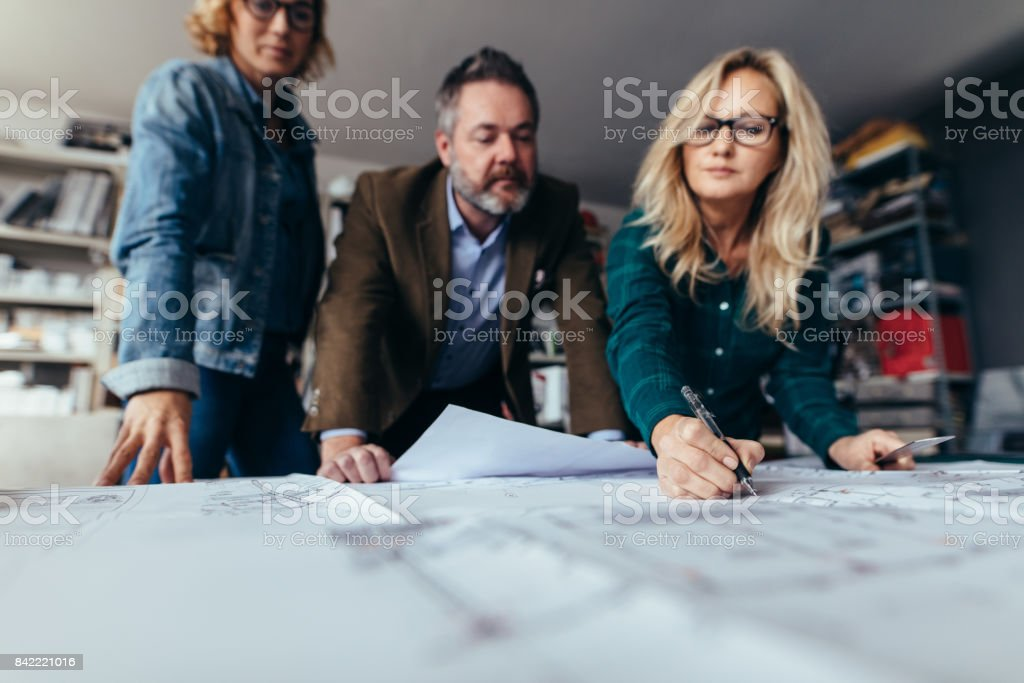 Business team discussing about errors in project stock photo