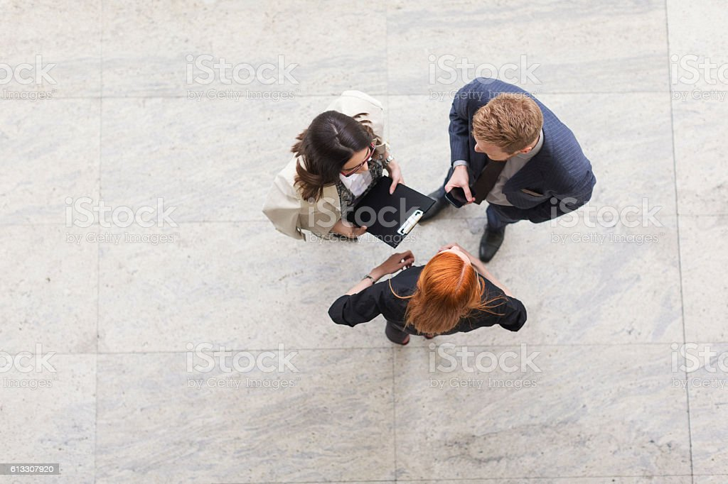 Business team discussing about work shot from above stock photo