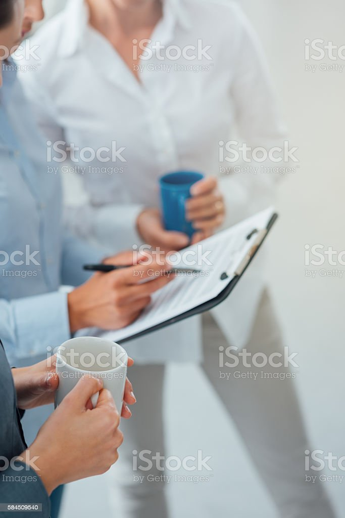 Business team discussing during a coffee break stock photo