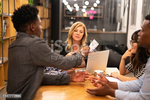 681735120istockphoto Business team discussing during a meeting with boss 1147772894