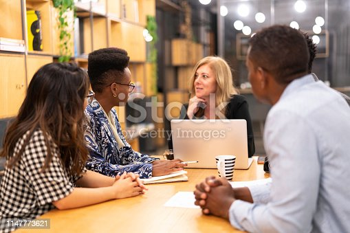 681735120istockphoto Business team discussing during a meeting with boss 1147773621