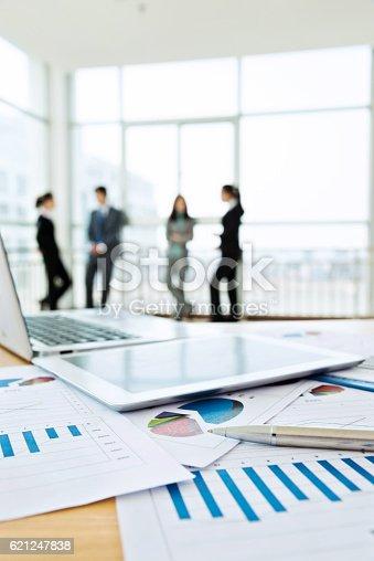 istock Business team discussing 621247838