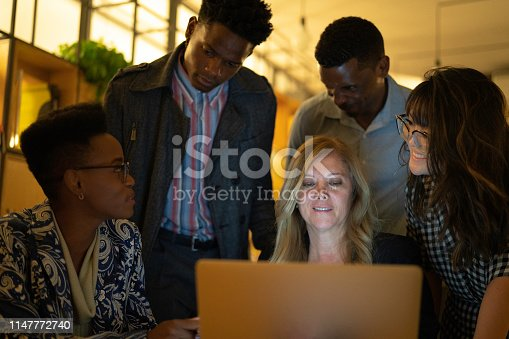 681735120istockphoto Business team discussing some information during a meeting 1147772740