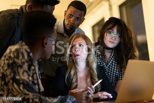 681735120istockphoto Business team discussing some information during a meeting 1147776404