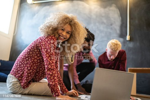681735120istockphoto Business team discussing some papers on the floor in the office 1147397609