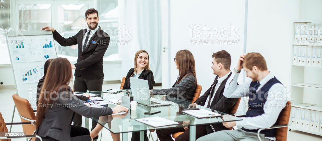 business team discussing the presentation of a new financial project on a workplace at office stock photo
