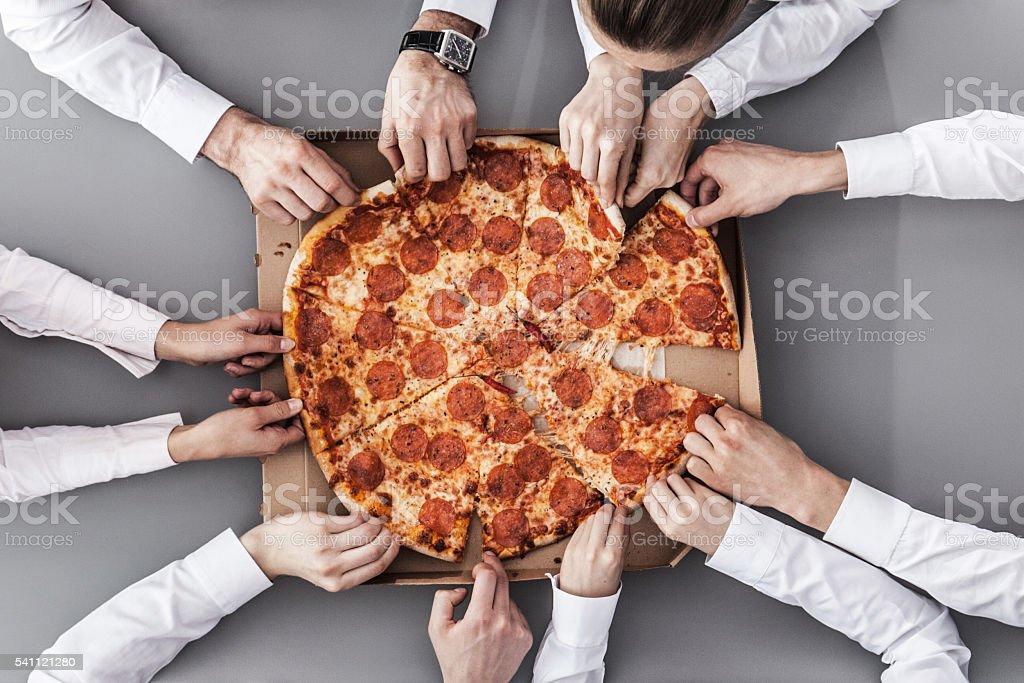 Business-team Essen pizza – Foto