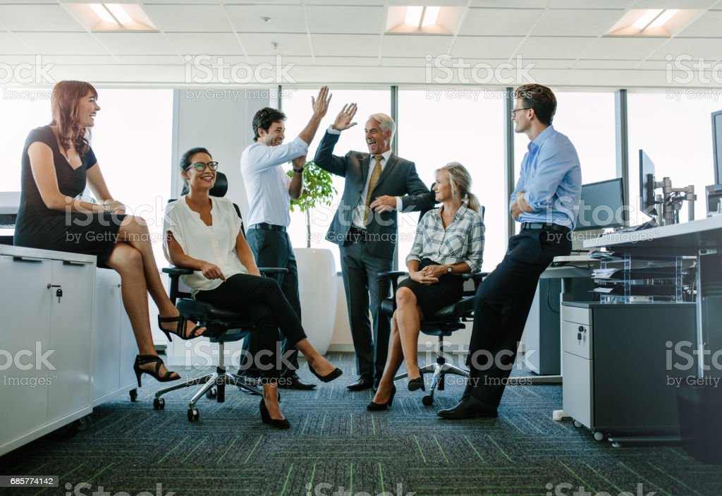Business team enjoying success at office royalty-free stock photo