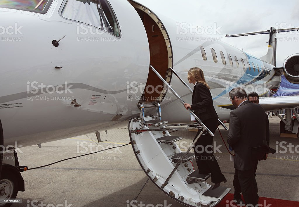 business team getting in the corporate jet royalty-free stock photo