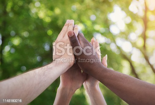 istock Business team giving group high five in park 1145183216