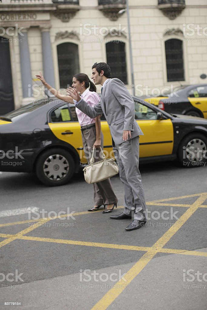 Business team hailing cab royalty-free stock photo