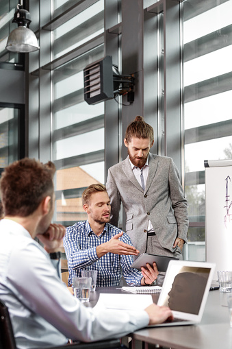 Business Team Having Brainstorming In An Office Stock Photo - Download Image Now