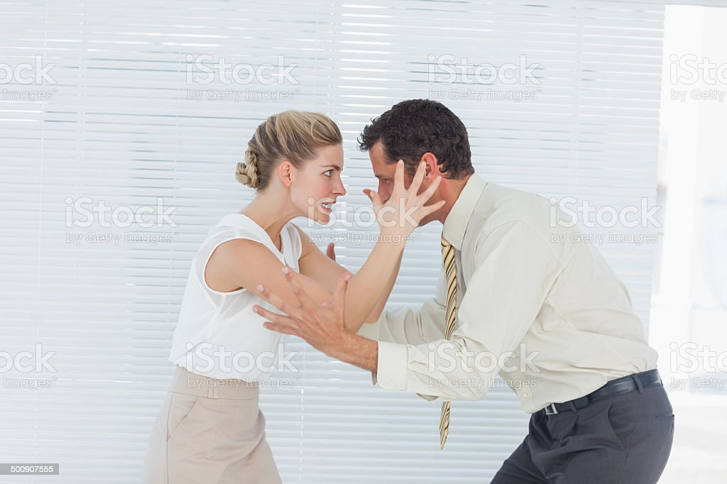 Business team having heated argument stock photo