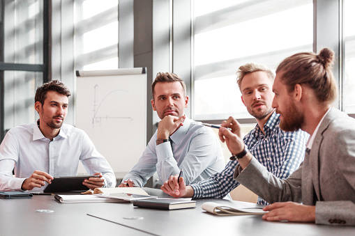 Business Team Having Meeting In A Board Room Stock Photo - Download Image Now
